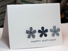 sweet clean & simple card with three punched flowers from three different papers...