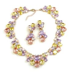 """Wonderful colored link rhinestone necklace with earrings. Length of necklace 15.00"""" and extension 2.50"""", clips earrings 2.75"""""""
