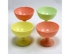 Moderntone sherbet dessert dishes, made by Hazel Atlas Glass Company in the 1950s. Glass with a fired-on painted finish in pastel colors.