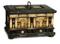 A MALINES ALABASTER AND EBONISED-WOOD CASKET  17TH CENTURY  WITH ENGRAVED INSET PANELS, THE INTERIOR WITH MARBLED PAPER LINING AND A SIDE CONTAINER, ONE SIDE LIFTING UP TO REVEAL TWO SECRET DRAWERS 12¼ IN. (31 CM.) WIDE