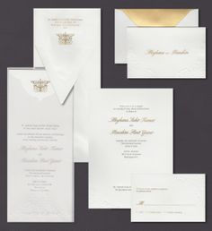 Our Embossed Scroll invitation suite is shown here engraved with gold ink.