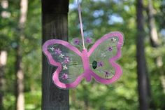 Butterfly: Clear contact paper (from the Dollar Store)  small flowers, leafs, and leaf stems found outside  Colorful card stock cut out into the shape of a butterfly or any other shape you want.