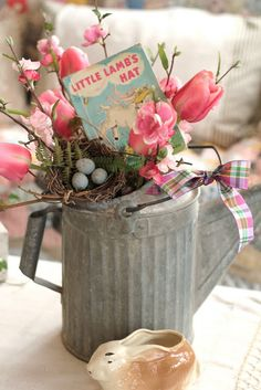 Vintage aluminum watering can with whimsical spring arrangement....Common Ground: Vintage Inspiration Friday #32: Magazine Inspiration