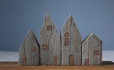 little wooden houses. by Jenny Walker