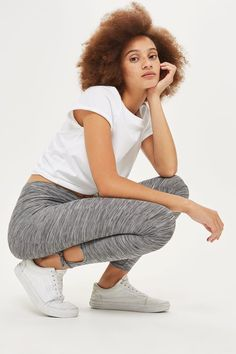 Every modern girl needs a flattering pair of leggings for those off-duty days. This sculpting pair in grey marl fabric feature ankle tie detailing and are as comfortable as they are chic.