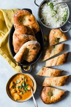 Chewy naan bread loaded with garlic and green onions.