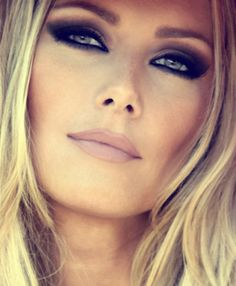 Smokey eyes and nude lips.