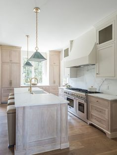 Transitional two-tone kitchen designed with a light oak kitchen island topped wi. Home Decor Kitchen, Interior Design Kitchen, New Kitchen, Home Kitchens, White Oak Kitchen, Wood Kitchen Island, Cuisines Design, Beautiful Kitchens, Kitchen Remodel