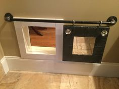 DOG DOOR; BARN DOOR; PIPE..This is Photo 2 of 3 for the dog door using ideas from other clever people for barn doors on the likes of closets, rooms, pantries...I had never seen a barn style, sliding, interior dog door. This is on the inside of the bathroom and goes into the Hallway of my house.  I also have dog doors allowing them t get outside but this one is decorative.