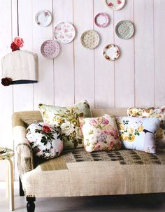 I love these pillows that look like they are made from vintage fabric and the fabric on the sofa!