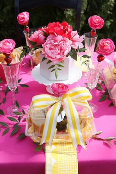 Gorgeous bright pink and yellow spring luncheon party tablescape. Fun idea for a boxed party favor, too! Pizzazzerie.com