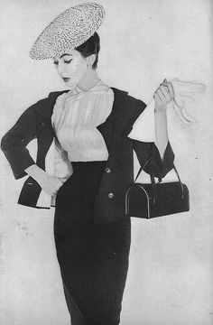 Adore the curve hugging lines of this chic look from 1953.