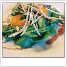 Spinach and mandarine orange salad.  Tossed with pine nuts, jicama, and a balsamic vinaigrette.