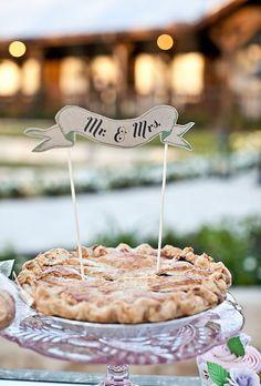 A pie with a banner wedding cake topper | Brides.com