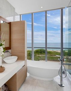 designer bathroom and free standing basin tub with oceanfront view