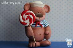 Little Boy Blue Fondant Bear with Lollipop.  via Etsy. SUGAR HIGH, INC