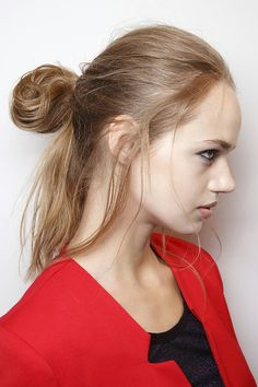 The half-up bun is having a definite moment, and this deconstructed version could not be easier. It's perfect for beach-tousled hair, dirty hair, clean hair. Just pull your hair back into a ponytail and create a loop, letting the ends hang loose. You can loosen strands around the face as well to soften the look or leave it as is.