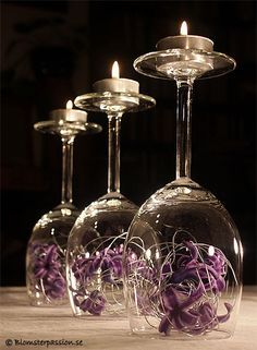 Idea from Blomsterpassion, wine glas up side down and candles abowe and flowers inside the glas