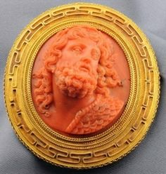 Fine Antique Coral Cameo Brooch, Depicting A Greek Hero, Perhaps Ulysses, Within A Frame Accented By Greek Key Motifs And Applied Ropetwist Borders, With Pendant Hook, Mounted In Gold c.1801-1908