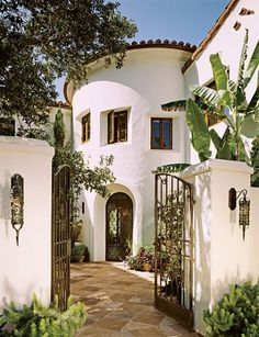 Spanish Colonial Revival - someday I will have a house like this in a warm place! Stucco, spanish tiles throughout, wrought iron details, terra rooftop, exposed wood ceiling beams...ugh!