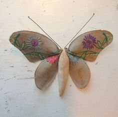 Soft sculpture of a moth made from Vintage textiles.