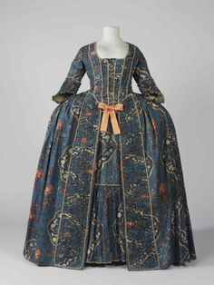 Robe à la francaise, France, c. 1760. Blue printed cotton with a pattern of large floral motifs in red, white and green, self-fabric trim, silk ribbon, linen lining.