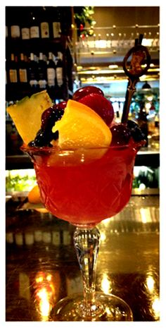 ROMAN PUNCH - circa 1862, (via: Bartender's Manual or How To Mix Drinks of the Present Style, by Harry Johnson, New York:  1888, DOWNTON ABBEY era), __  *Recipe #1 - - 1 tablespoon sugar,  1 tablespoon raspberry syrup, 1 teaspoon Curaçao, 1 wine-glass Jamaica rum,1/2 wine-glass brandy,  1/2 lemon juice, * *   Use large bar glass. Fill with shaved ice, shake well, dash with port wine, and ornament with fruits in season. Imbibe through a straw.