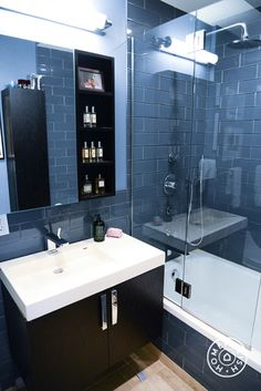 Inspiration Roundup: Beautiful Bathrooms - A masculine bathroom for an urban bachelor pad, this dark blue bathroom has the right amount of mood and sophistication to make any resident feel like they always have their life together while showering and shaving. - @Homepolish New York City More