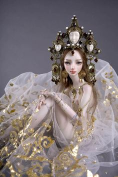 Russian jeweler artist and designer Marina Bychkova, who lives in Canada, creates stunning one-of-a-kind ball-jointed porcelain dolls for adults.