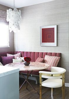 A custom-made channeled bench creates easy seating in the contemporary breakfast…