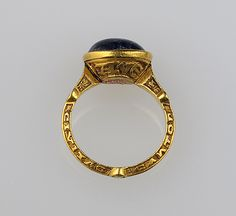 Date: 14th century Culture: British Medium: Gold and sapphire. The inscription on the hoop reads: Rutilalns Eboraci Civita[ti]s cantor (Rufus(?) of York, Musician(?) of the Episcopal city ).