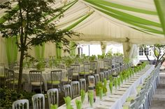 Marquee on a patio with a mix of trestle tables and round tables