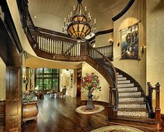 Curved staircase in foyer - see through to great room beyond