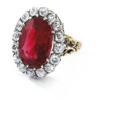 The Queen Maria-José ruby ring, an exceptional ruby and diamond ring, late 19th century - Set with an oval ruby stated to weigh 8.48 carats, framed with cushion-shaped diamonds.