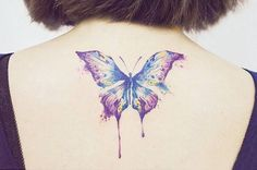 Butterfly tattoo on the upper back.
