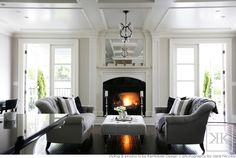 gorgeous living room...love the french doors, grey furniture, dark wood floors...