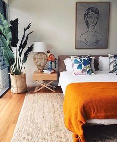 Example of how to display oversized art over a bed; large pen & ink (?) drawing of a woman #InteriorDesignPlants