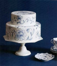 This jaw-dropping creation starts out simple -- two round tiers covered with fondant -- but added floral flourishes make it a rhapsody in blue. Cheryl Kleinman in Brooklyn, New York, created this masterpiece by hand-painting the flowers Gorgeous Cakes, Pretty Cakes, Amazing Cakes, White Fondant Cake, Cake Fondant, Fondant Figures, Bolo Floral, Floral Cake, Purple Wedding Cakes