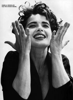 "1991, Isabella Rossellini. This is what hair happiness looks like. The mess, the face, the hands all ""WHA? YES!""  She's a picture."