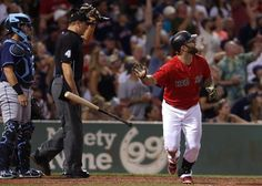 Boston, MA - 07/31/15 - (7th inning) Boston Red Sox first baseman Mike Napoli (12) watches the flight of his two run home run in the seventh inning. The Boston Red Sox take on the Tampa Bay Rays in Game 1 of a three game series at Fenway Park. - (Barry Chin/Globe Staff), Section: Sports, Reporter: Julian Benbow, Topic: 01Red Sox-Rays, LOID: 8.1.2442125440.