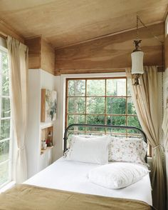 You can put a bed in front of a window and you can offset a hanging light