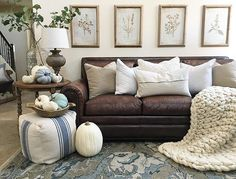 Classic Living Room With White Brick Fireplace And Brown