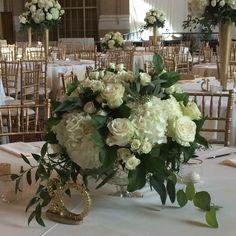 Beautiful white hydrangeas, roses, and eucalyptus