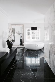 Minimalist white and black marble bathroom  Home Decor Inspiration home decor, home inspiration, furniture, lounges, decor, bedroom, decoration ideas, home furnishing, inspiring homes, decor inspiration. Modern design. Minimalist decor. White walls. Marble countertops, marble kitchen, marble table. Contemporary design. Mid-century modern design. Modern rustic. Wood accents. Subway tile. Moroccan rug.