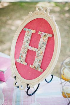 Whimsical First Birthday Party... Lots of good ideas. Button monogram, decorated wooden high hair, birthday crown...