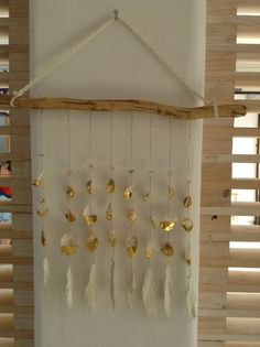 Handpicked in Sayulita - seashell mobiles feathered in gold on leather