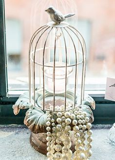 Sweet and romantic, this vintage inspired metal birdcage will give your tables an elegant vibe.