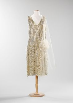 Dress, Evening, ca. 1925. French. The Metropolitan Museum of Art, New York. Brooklyn Museum Costume Collection at The Metropolitan Museum of Art, Gift of the Brooklyn Museum, 2009; Gift of William Garrigues, 1967 (2009.300.1330) | During the 1920s, the days were for working and the nights were for dancing. Women's dress was liberating, as the hemlines rose and the waistlines dropped. Evenings were spent at clubs and it was common to see ladies dancing the Charleston and Black Bottom.