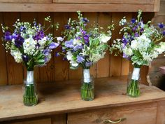 Bridesmaids posies with sweet peas and white narcissus