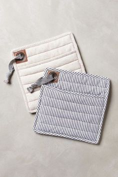 Portsmouth Potholder - anthropologie.com | stripes and natural canvas potholder. I love the grommet detail and leather patch. You can use this idea with the Radiant Home Studio potholder tutorial!